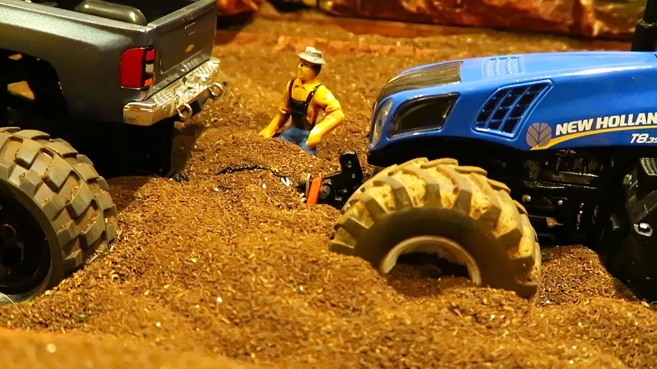 RC TRACTOR STUCK IN MUD WITH HEAVY FARM MACHINERY - TRACTORS & BIGFOOT TRUCK IN FARMING ACTION