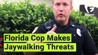 This Florida cop threatens to put a young black man in jail for all...