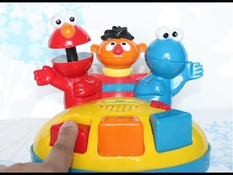 Sesame Street Giggle Gang Surprise Musical Piano Toy