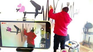 pintando el logotipo de una clinica de belleza/ LopHer