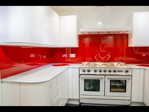 red-glass-kitchen-splashback-and-white-glass-worktop-installation--creoglass