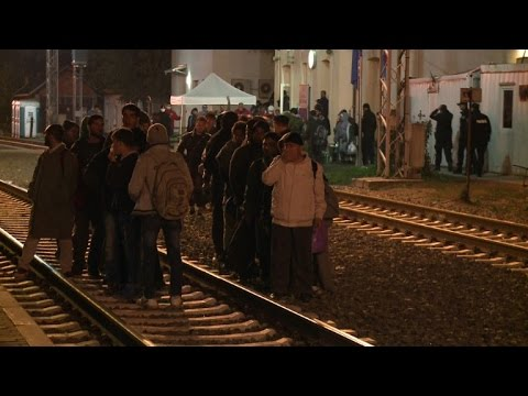 Hundreds of migrants board trains in eastern Croatia