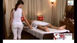 Busty masseuse in undershirt gives massage #1
