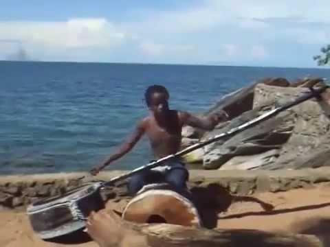 Gasper Nali sings and makes music with a guitar on a rope