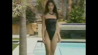 Miyuki poses in a great black highleg swimsuit combined with black ...