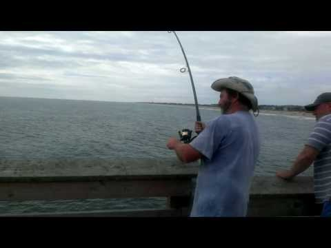 Pier fishing in Nags Head at the Outer Banks NC.
