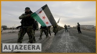 Turkey-backed Syrian fighters 'seize' key town in offensive