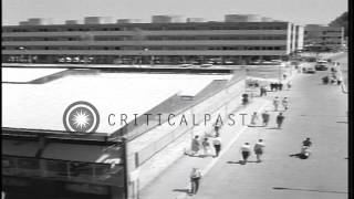 Athletes come off bus and arrive at the stadium during Summer Olympics of 1960 in...HD Stock Footage