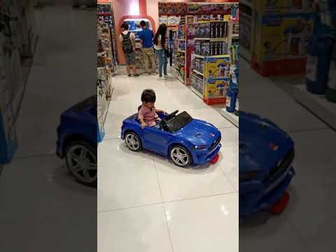 Jarvis driving a Mustang GT toy car