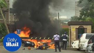 Several cars on fire amid reports of explosions at Nairobi hotel