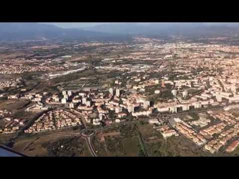 Landing into Perpignan Rivesaltes airport. Awesome French city aerial view (FULL HD).