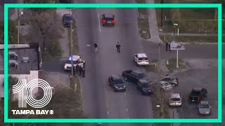 2 police officers shot near do…