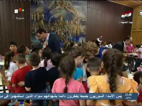 assad-with-asma-visiting-children