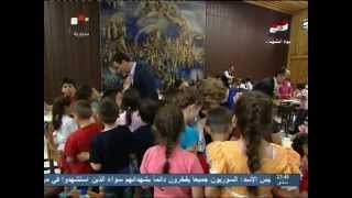 Assad with Asma, visiting children