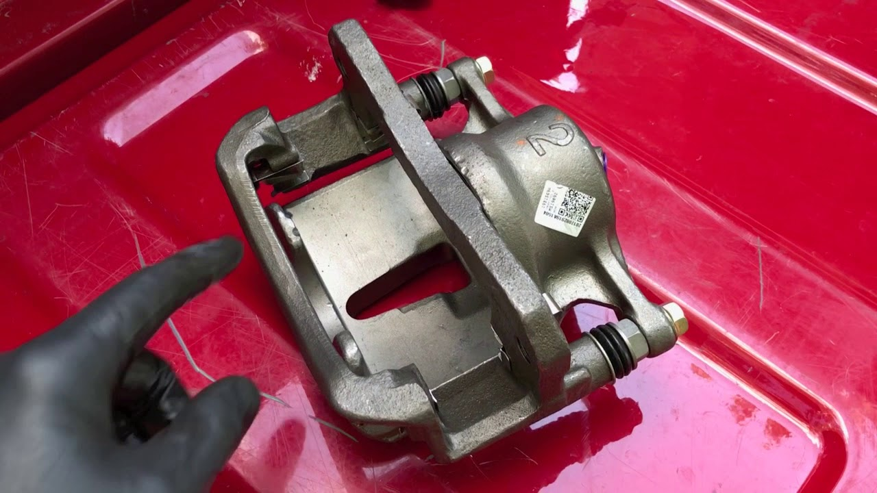 installing brake pad caliper tension clips  [ 1280 x 720 Pixel ]