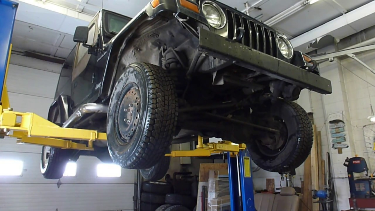 clutch master and slave cylinder replacement on a jeep wrangler tj [ 1280 x 720 Pixel ]