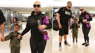 doting mom amber rose holding hands with her adorably shy son sebastian