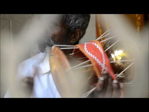 tamil man (indian) playing RARE ancient devotional music instrument(udukkai)(உடுக்கை ,பூசாரி)