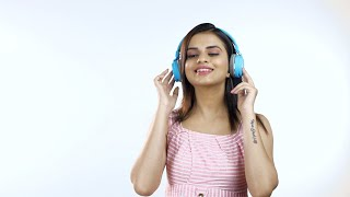 Smiling Indian woman listening to music and enjoying - lifestyle. White background