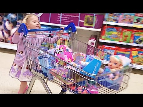 Ava Fills A Trolley Full Of Toys