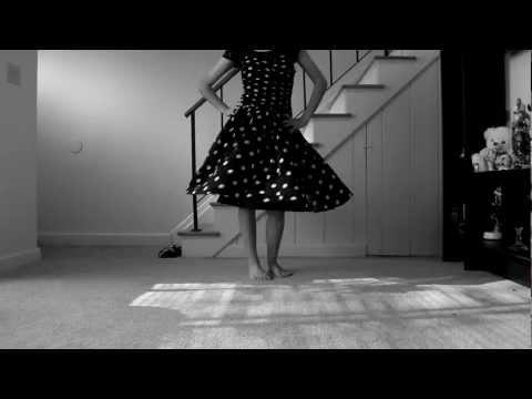 Black dress with white polka-dots