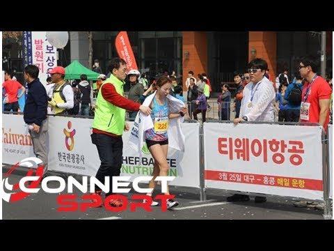 안슬기 '옷핀 투혼' 대구국제마라톤 2위 골인