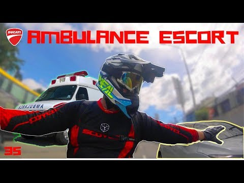 DUCATI RIDER HELPING AMBULANCE   AMBULANCE ESCORT   TRAFFIC EMERGENCY