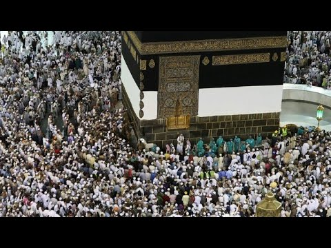 Muslim worshippers perform prayers around the Kaaba