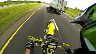 Biker Escapes Police While Doing Wheelies