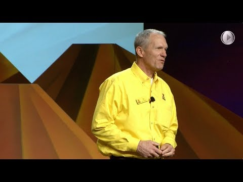 Pat Hittmeier on stage in Phoenix Tells Franchisees to be Proud of Accomplishments