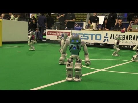 Robot Footballers Kick Off Their World Cup