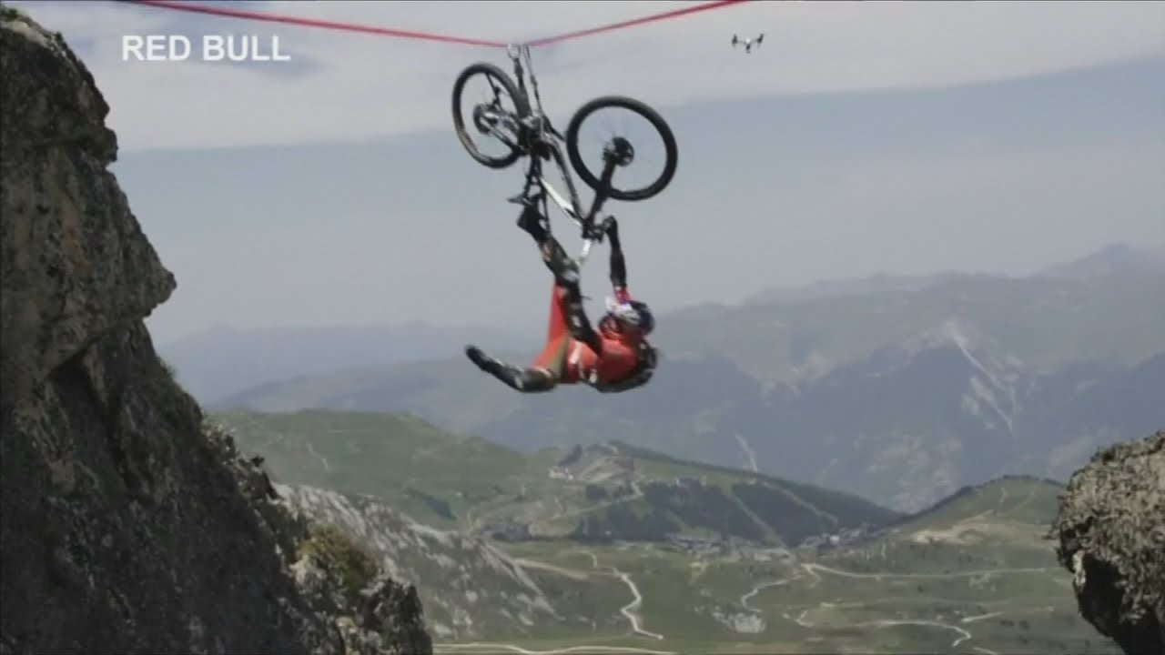 Cyclist falls off tightrope over 120 metre drop in French Alps - YouTube