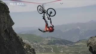 Cyclist falls off tightrope over 120 metre drop in French Alps