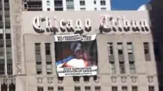 Unknown activists placed #savedonbasspeople banner on the Chicago Tribune Tower.{slow mo}  2015/5/19