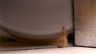 Tarkashi - Shot of man cutting a piece of wood with the circular saw