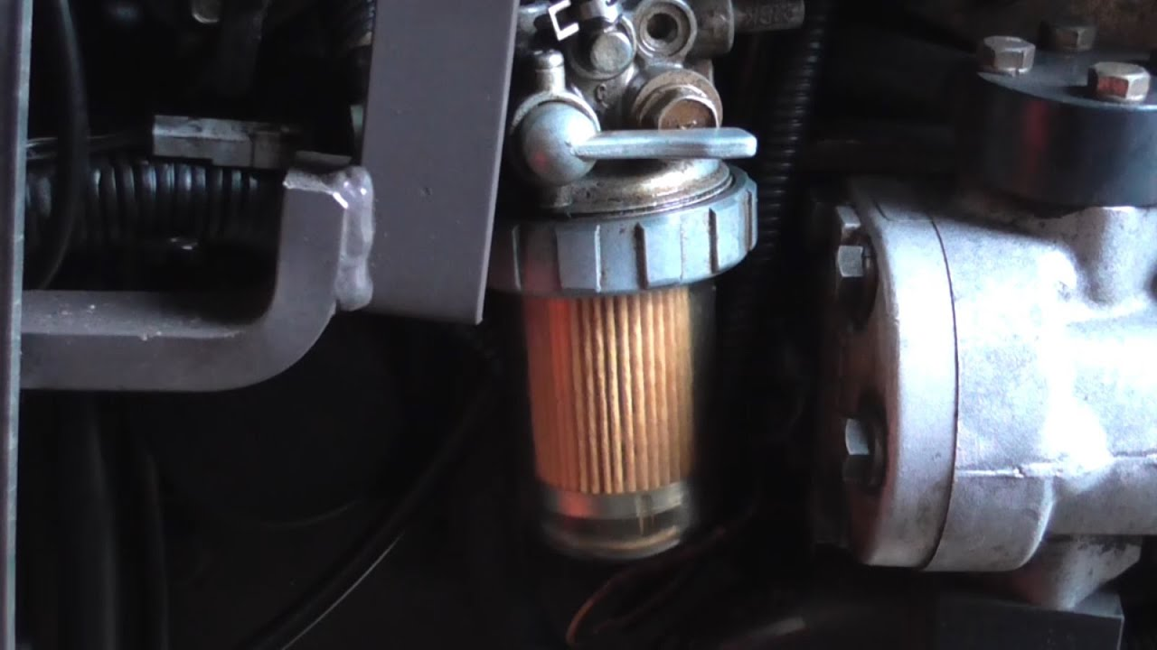 fuel filter replacement on a massey ferguson 1220 compact tractor