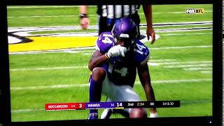 Stefon Diggs gestures in sync with announcer Thom Brennaman