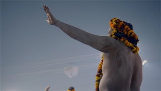 An Indian monk or a priest smeared with holy ash all over his body at the Kumbh, India