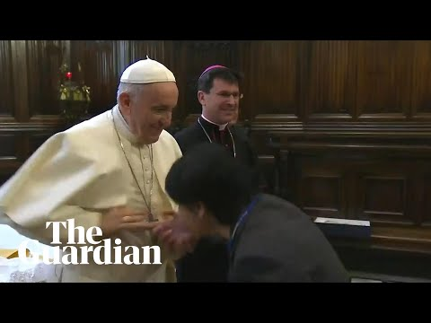 Pope Francis rebuffs worshippers trying to kiss his ring