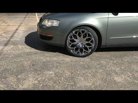 "2006 Volkswagen Passat sitting on 20"" Azara-504 wheels wrapped around 225/35 Lexani tires."