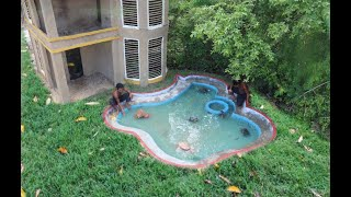 Building the more creative fish pond front of mud villa house