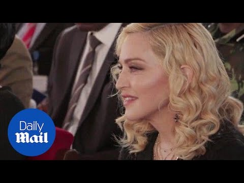 Madonna opens paediatric hospital in Malawi with her adopted twins - Daily Mail