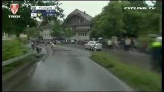 Huge high speed descent crash at 2010 Tour de Suisse in the rain.