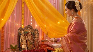Indian woman in saree worshipping Ram Darbar / family idols at home - Puja Festival Celebration