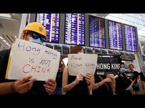 """Jogo do """"gato e do rato"""" em Hong Kong"""