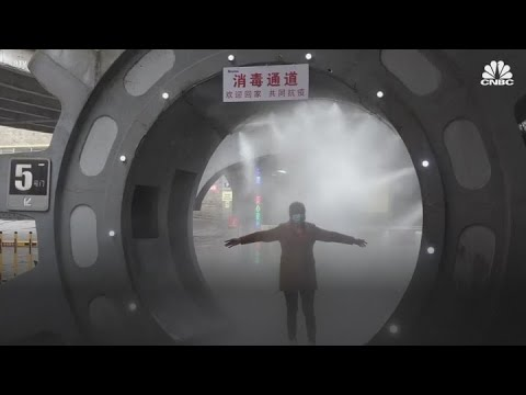 Coronavirus-cases-soar-beyond-60000-and-China-installs-a-disinfectant-tunnel