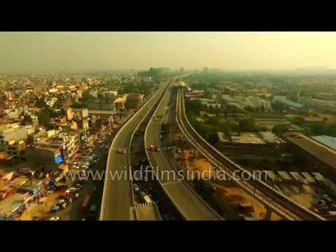 Aerials of Metro lines, highways, trains and traffic: The New India