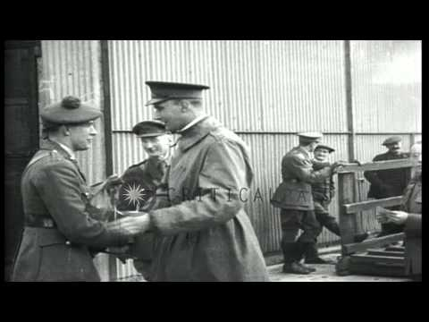 American Army personnel in conversation at a dock in England during World War I HD Stock Footage