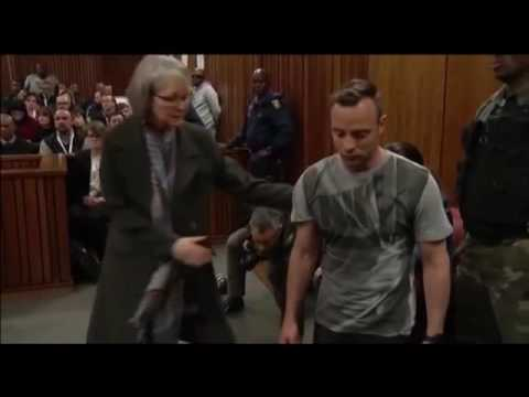 Oscar Pistorius stuns court by removing prosthetic legs and hobbling through room during sentencing
