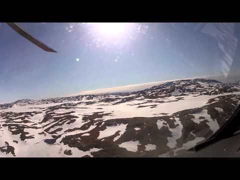 Flying from Isortoq mountain to a drilling location March 2011